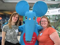 Blue mouse posing with WLT staff