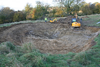 The pond being constructed