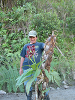 FJ staff member with rescued orchid