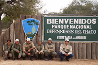 Defensores del Chaco sign and park rangers