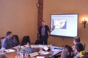 Photograph of John Burton presenting at the round table in Yevevan