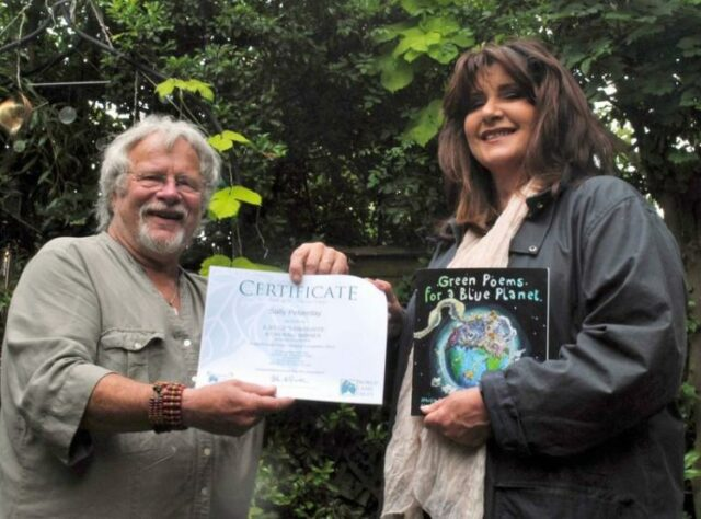 Photograph of Bill Oddie presenting Sally Peberday with her prize. © Chris Jenkin / Enterprise Plants.