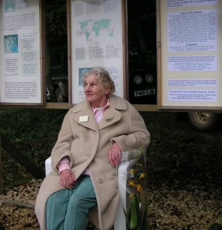 Jane Pointer sitting in front of display boards at Kites Hill.