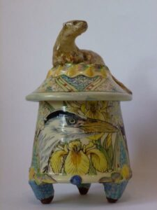 Close up of Maureen Minchin's ceramic pot with the lid in the shape of an otter.