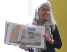 Nicola Davies holds up a copy of The Promise at Edgar Sewter Primary School assembly.