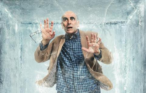 Man suspended in a block of ice.