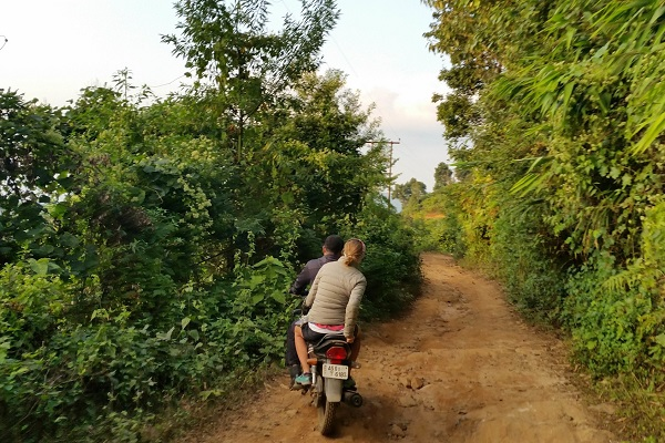 Cycling up the mud track in Garo Hills. Image: Camilla and Julian Read
