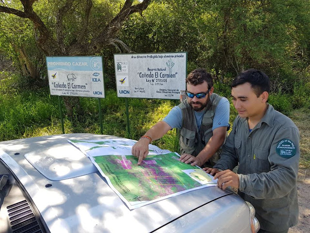 Staff from GUYRA Paraguay looking at a map