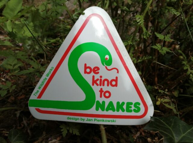 'be kind to snakes' sing, designed by Jan Pienkowski.