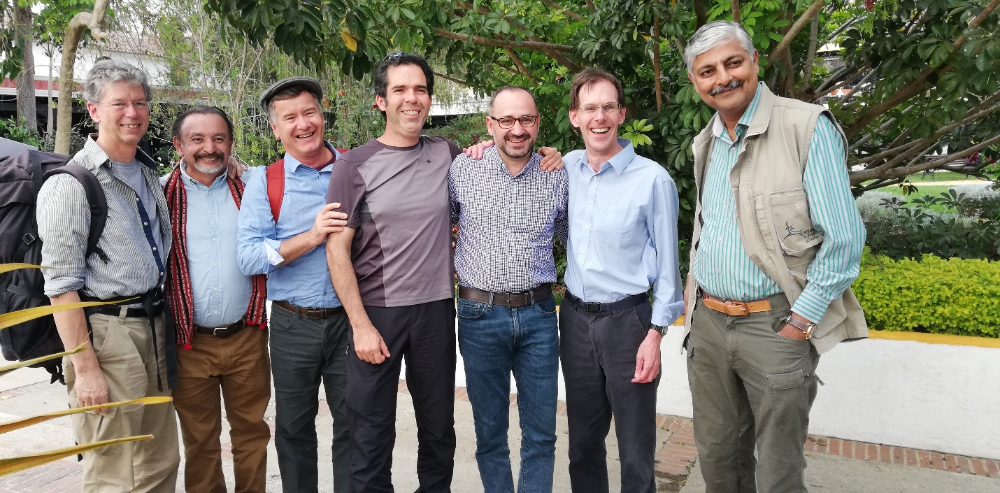Dr Jonathan Barnard stands shoulder to shoulder with six conservation colleagues representing six WLT partners.